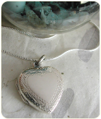 Engraved Sterling Silver Heart Locket With Border